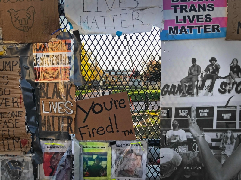 Protest banners on the fence, looking through to the White House
